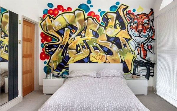 quarto adolescente com parede grafitada